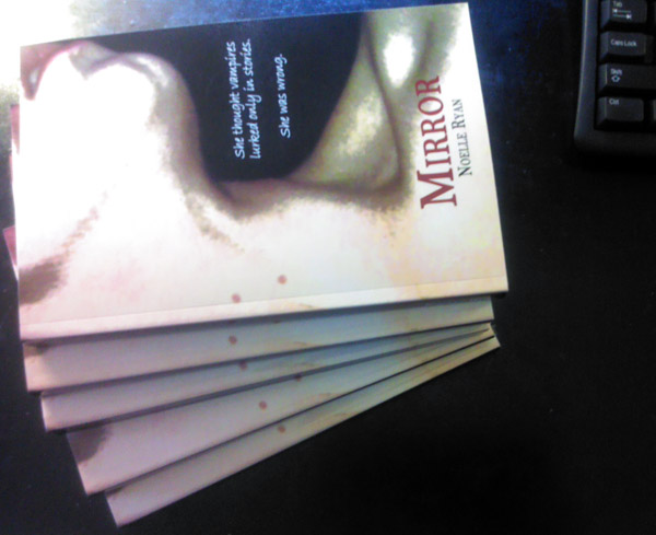Stack of 5 copies of Mirror on my desk